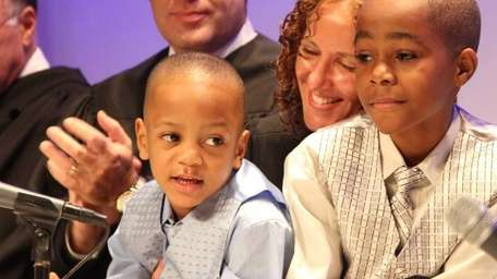 Jeremiah Taylor, 4, left, and brother Gregory, 9,