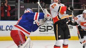 Rangers goalie Martin Biron shoves Calgary's Curtis Glencross
