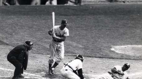 Jackie Robinson of the Brooklyn Dodgers steals home