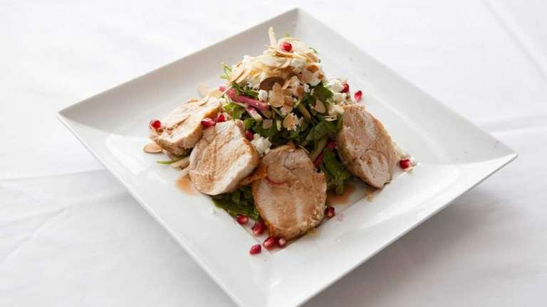 A turkey-pomegranate salad is made with turkey, greens,