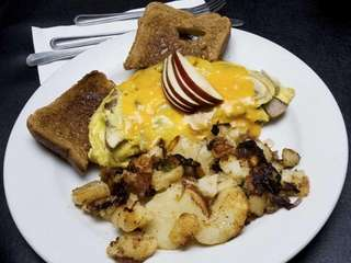 Sausage, apple and cheddar cheese omelette with homefries