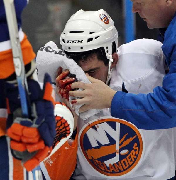 New York Islanders Mike Mottau is helped off