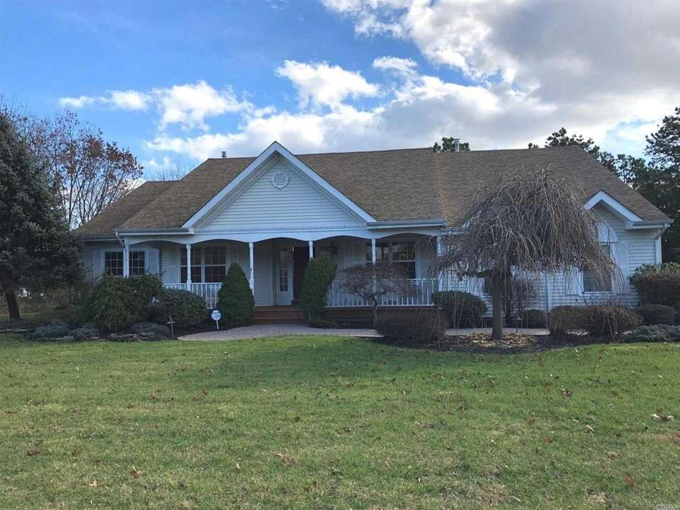 This East Setauket ranch includes four bedrooms and