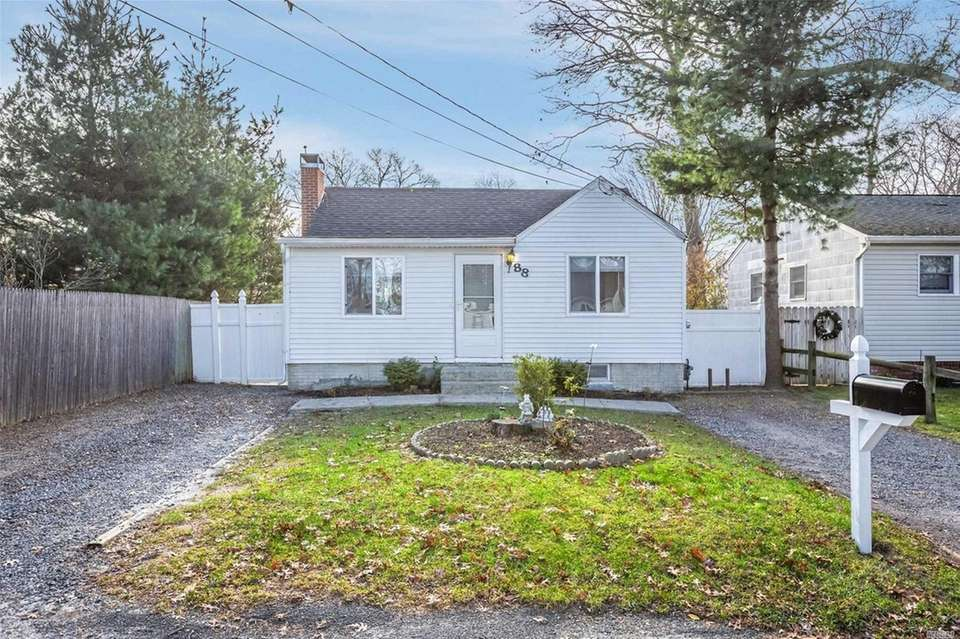 This Patchogue ranch includes three bedrooms and one