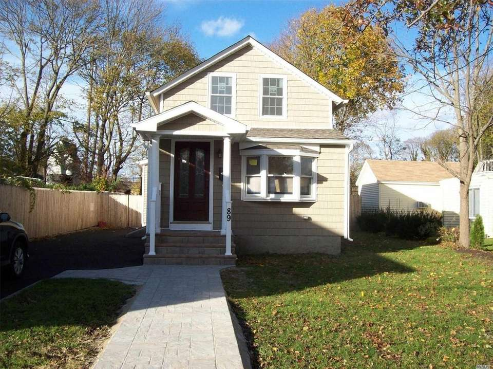This Sayville Cape includes three bedrooms and 1