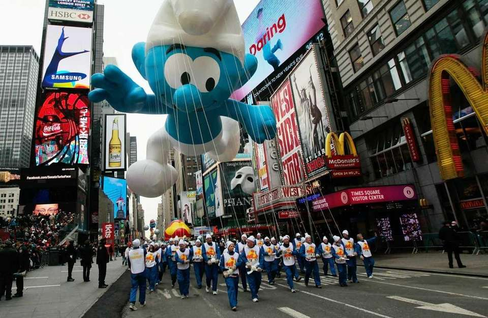 The Smurf float moves through Times Square during