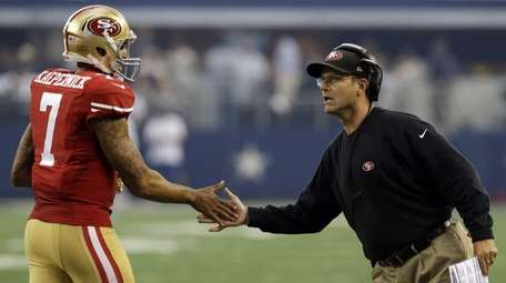 Then-49ers coach Jim Harbaugh, who helped develop quarterback
