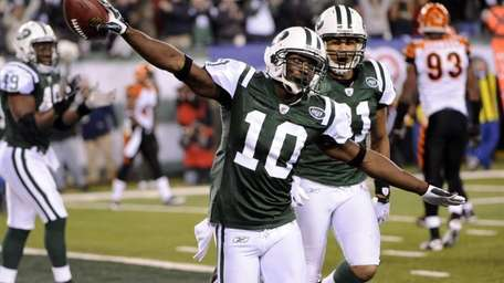 Jets wide receiver Santonio Holmes celebrates after scoring