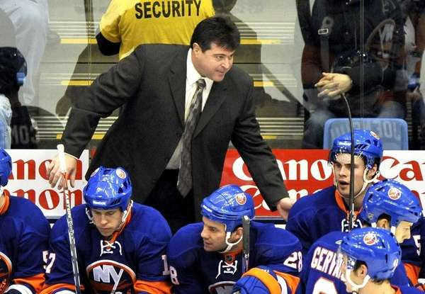 Islanders coach Jack Capuano, top, talks to his