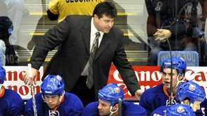 Islanders coach Jack Capuano, top, talks to his