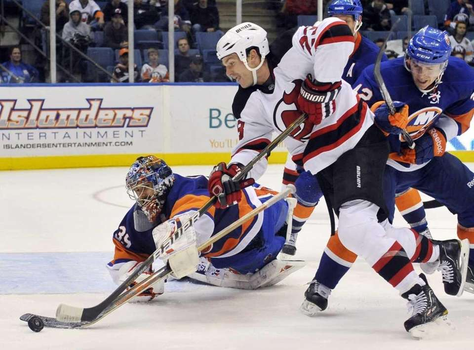 Rick DiPietro dives to knock the puck away
