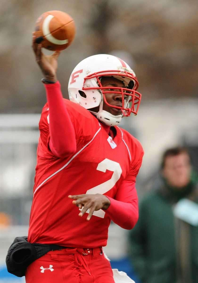Freeport quarterback Isaiah Barnes throws a pass in