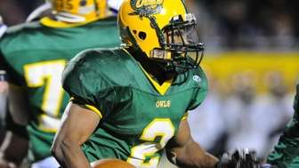 Lynbrook running back Travis Lock rushes for yardage