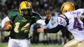 Lynbrook quarterback Paul Magloire, left, attempts to evade