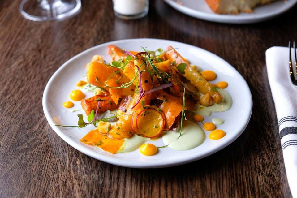 Carrots served with goat cheese, radish and hazelnut