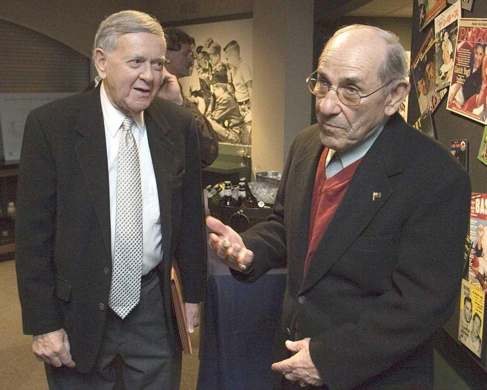 Yogi Berra, right, and broadcaster Bob Wolff talk