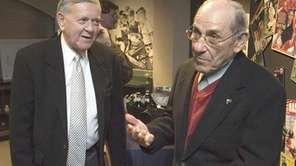Yogi Berra, right, and broadcaster Bob Wolff talk