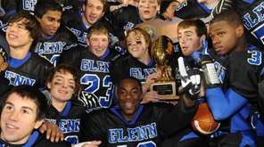 The Glenn football team gathers around the championship
