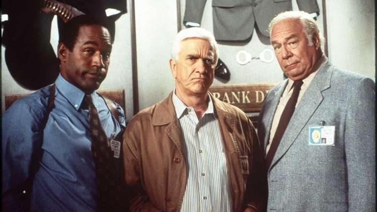 Leslie Nielsen, center, with co-stars O.J. Simpson and