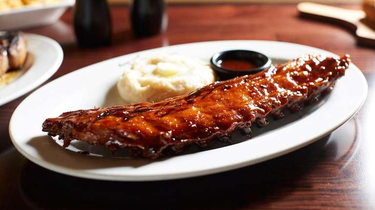 Baby back ribs are amply sauced and both