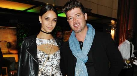 April Love Geary and Robin Thicke at a