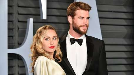 Miley Cyrus and Liam Hemsworth attend the 2018
