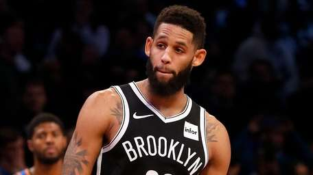 The Nets' Allen Crabbe looks on during the