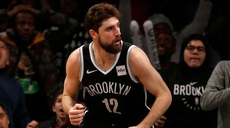 The Nets' Joe Harris reacts after his layup