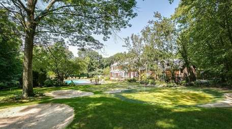 This Laurel Hollow is on the market for