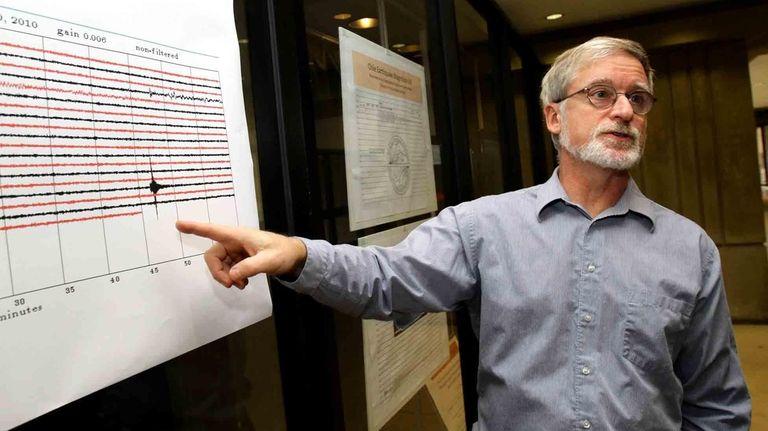 Stony Brook University geology professor Daniel Davis points