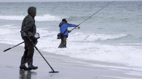 A surf fisher braves the chilly temperatures as