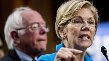 Sen. Elizabeth Warren, D-Mass., speaks as Sen. Bernie