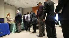 Job-seekers at a job fair in the Newsday
