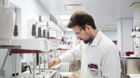 Scientist Nick Russo works on pill-testing procedures at
