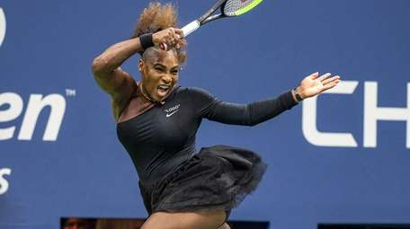 Serena Williams of USA hitting a forehand against