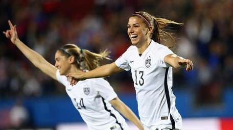 Alex Morgan celebrates her goal in the first