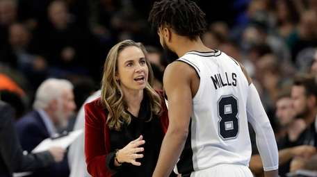 San Antonio Spurs assistant coach Becky Hammon, left,