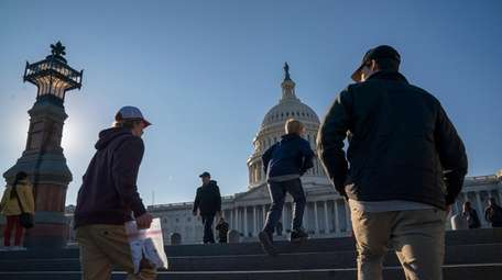 People visit the Capitol in Washington on Wednesday