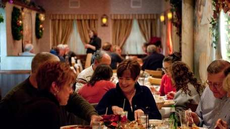 Diners dig into a variety of dishes at