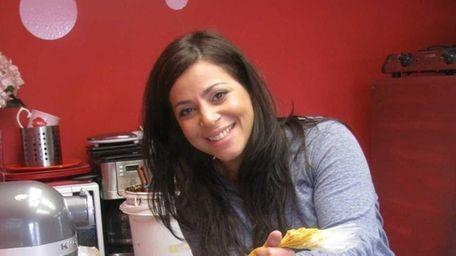 Proprietor Corina Elgart works at her bakery, Taste