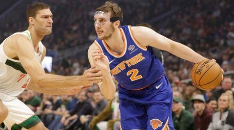 New York Knicks' Luke Kornet drives against Milwaukee