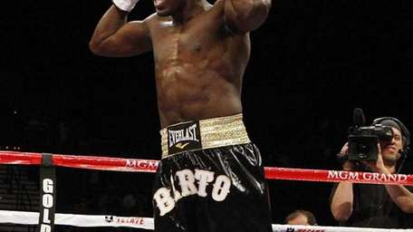 Andre Berto celebrates his first-round win over Freddy