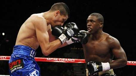 Andre Berto, right, lands a punch that sends