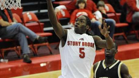 Stony Brook's Dave Coley goes up for a