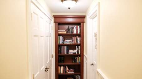 A bookcase in the Rockville Centre home contains