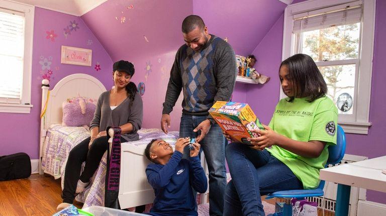 Kimberly and Dermond Thomas encourage their children, Cole,