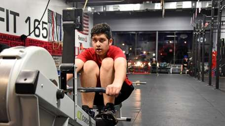 Omar Emami, 13, works out at SC Crossfit