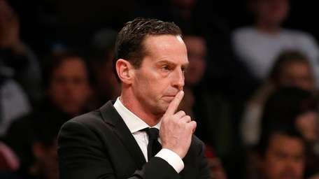 Nets coach Kenny Atkinson looks on against Charlotte