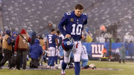 Eli Manning leaves after a loss against the
