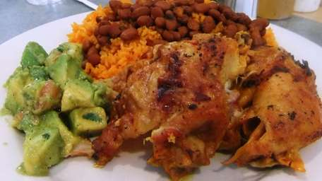 Merengue's baked chicken with rice & beans and